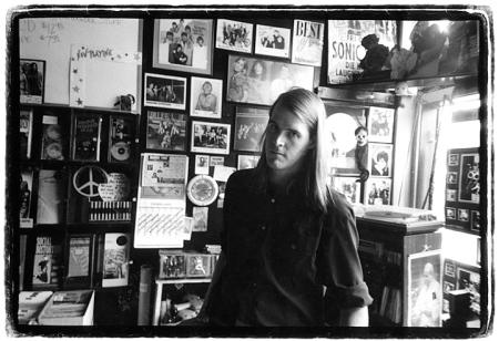 photo of Damain Strigens behind the counter at Atomic circa 1991